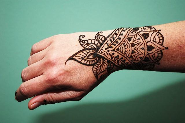 Green Henna Wrist Tattoo: Henna Wrist And Green Wall