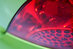 flower(0.0), glass(0.0), petal(0.0), automotive tail & brake light(1.0), automotive lighting(1.0), red(1.0), light(1.0), macro photography(1.0), close-up(1.0), circle(1.0),