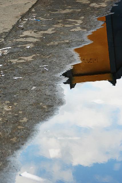 wet yellow dumpster