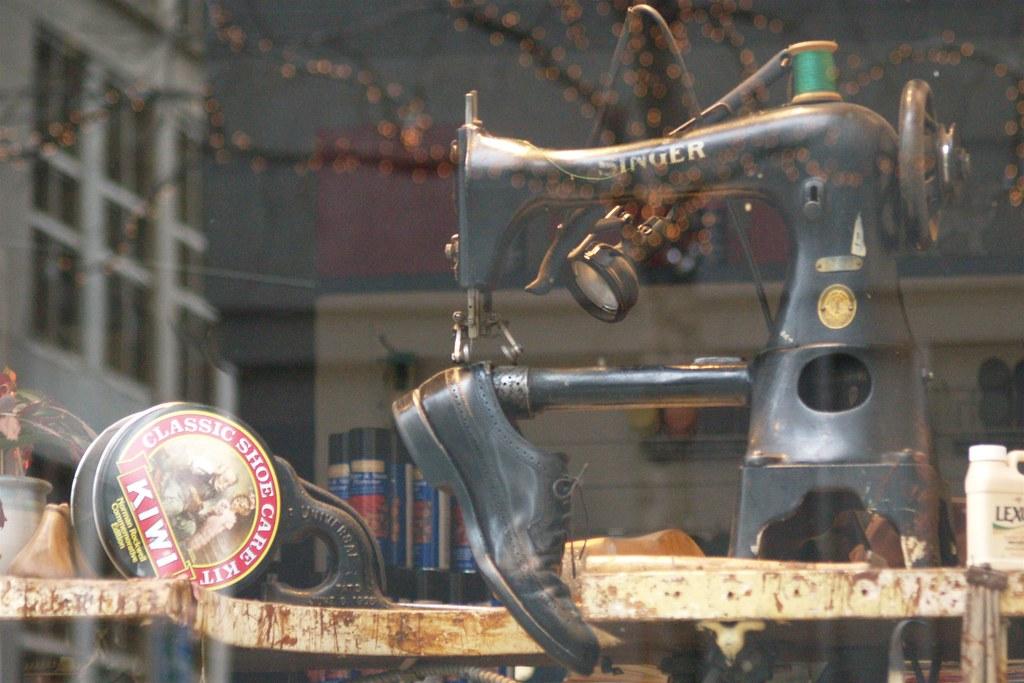 Kiwi Kit, Singer & Shoe In The Window Of Ramuta's Shoe Repair (Seattle, WA)