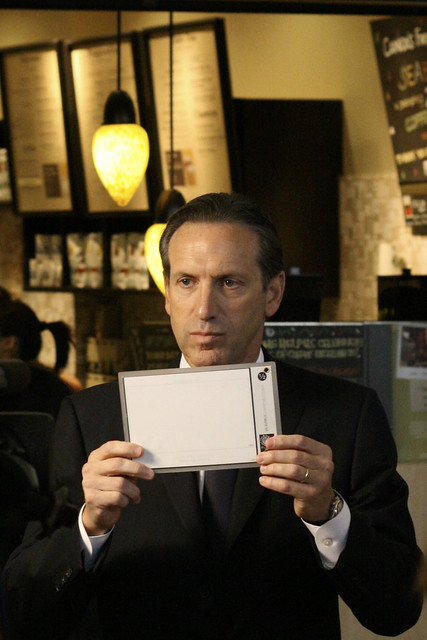 Starbucks Chairman Howard Schultz Holds Up White Balance Card