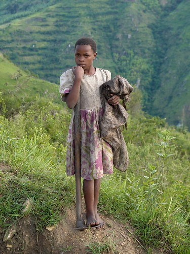 Girl working at the hills near Kayonza