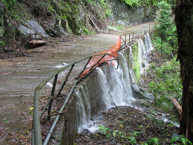 Crystal Cascades in Flood Cairns 20 Apri Pathway & Damaged Fence