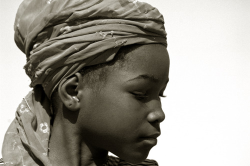 Portrait of an african girl wearing a traditionnal boubou style hat