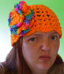 dastar(0.0), cap(0.0), art(1.0), face(1.0), clothing(1.0), head(1.0), beanie(1.0), hat(1.0), crochet(1.0), knit cap(1.0), headgear(1.0),