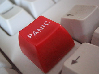 "An image of a computer keyboard with a red key reading ""PANIC"""