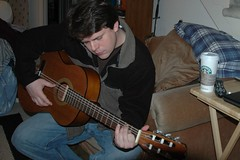 learn playing guitar