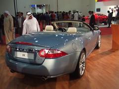 aston martin db9(0.0), automobile(1.0), automotive exterior(1.0), executive car(1.0), wheel(1.0), vehicle(1.0), performance car(1.0), automotive design(1.0), jaguar xk(1.0), personal luxury car(1.0), land vehicle(1.0), luxury vehicle(1.0), convertible(1.0),
