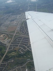 runway(0.0), aircraft(1.0), aviation(1.0), bird's-eye view(1.0), wing(1.0), plain(1.0), aerial photography(1.0), flight(1.0),