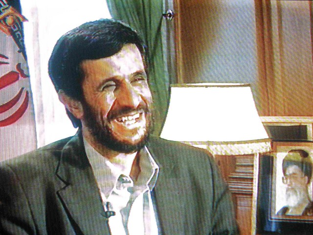 Drawing of a laughing Ahmadinejad