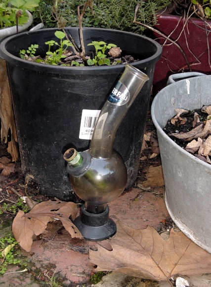 Disused bong in garden setting
