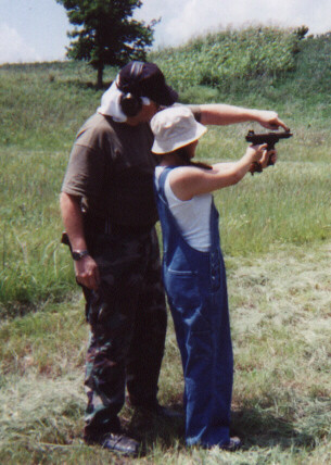 Dad B shows me how to aim the Tech-9..