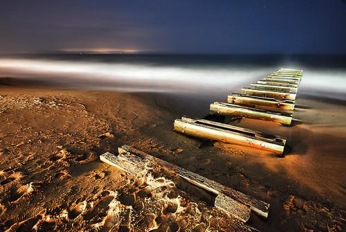 ocean longexposure sea beach water night evening pier sand nikon waves dusk wide footprints sigma wideangle atlantic delaware d200 1020mm tides rehobothbeach 2007 lunarlandscape nikonstunninggallery