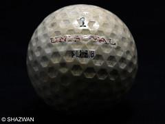 circle(0.0), sphere(1.0), golf ball(1.0), macro photography(1.0), golf equipment(1.0), ball(1.0),