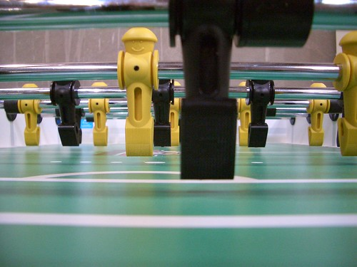 Foosball table from on-the-field vantage point.