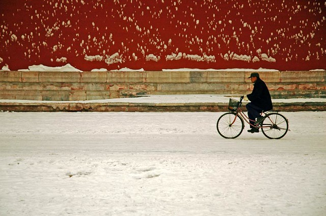 Riding A Bike at Forbidden City in the Snow