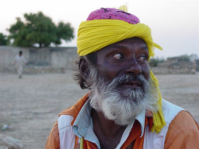 Portrait of a 75 year old colorful snake charmer -District Thatta, Sindh, Pakistan