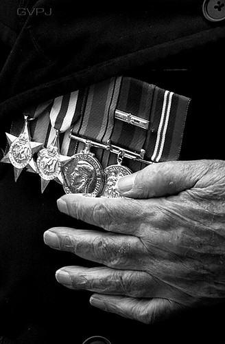 WW2 Veteran  Raymond Stockton holds his heart under his medals