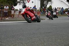 stunt(0.0), vehicle(1.0), race(1.0), motorcycle(1.0), road racing(1.0), motorcycling(1.0), stunt performer(1.0), race track(1.0), isle of man tt(1.0),