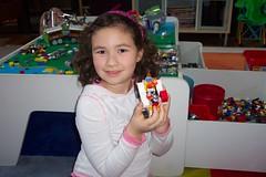 Aidan shows off her lego creation