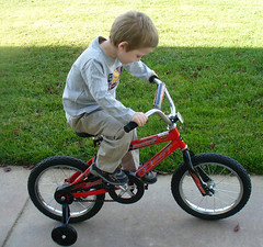 mountain bike(0.0), bicycle motocross(0.0), tricycle(0.0), wheel(1.0), vehicle(1.0), training wheels(1.0), bmx bike(1.0), sports equipment(1.0), cycle sport(1.0), bicycle(1.0),