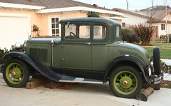 sedan(0.0), automobile(1.0), ford model a(1.0), ford model a(1.0), vehicle(1.0), ford model y(1.0), touring car(1.0), antique car(1.0), classic car(1.0), vintage car(1.0), land vehicle(1.0), luxury vehicle(1.0), motor vehicle(1.0),