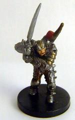 army men(0.0), miniature(0.0), iron(0.0), metal(1.0), bronze sculpture(1.0), figurine(1.0), bronze(1.0),