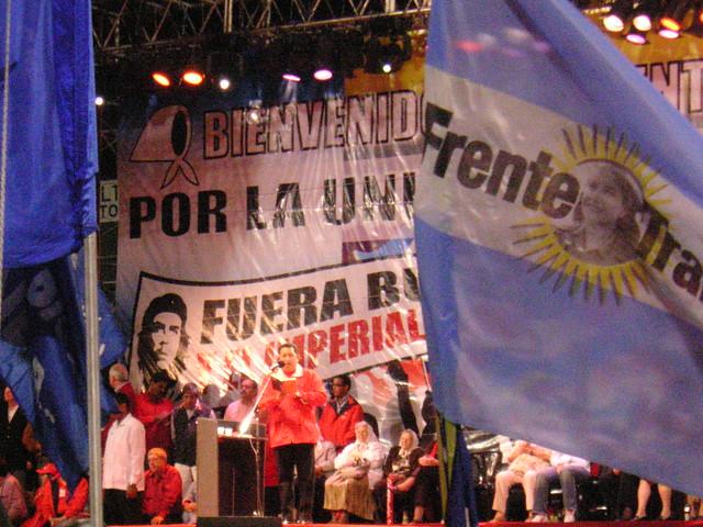Hugo Chavez between the flags