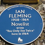 Sign about Ian Fleming on the side of The Duck Inn pub, Pett Bottom