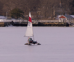 sailing ship(0.0), winter(0.0), sea(0.0), watercraft(0.0), boat(0.0), sail(1.0), sailboat(1.0), vehicle(1.0), sailing(1.0), ice boat(1.0), mast(1.0), boating(1.0),