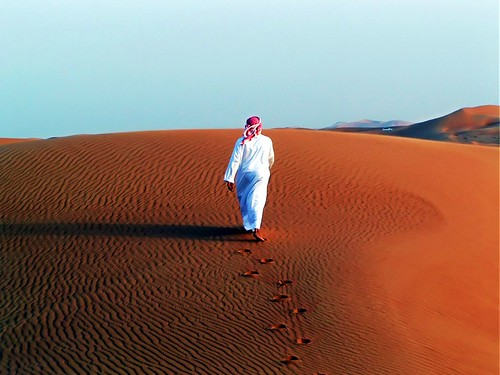 Arab walking in desert