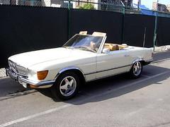 executive car(0.0), performance car(0.0), mercedes-benz 450sel 6.9(0.0), sports car(0.0), automobile(1.0), automotive exterior(1.0), wheel(1.0), vehicle(1.0), mercedes-benz r107 and c107(1.0), mercedes-benz(1.0), bumper(1.0), antique car(1.0), classic car(1.0), land vehicle(1.0), luxury vehicle(1.0), convertible(1.0),