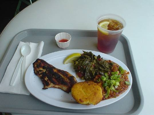 Blackened catfish, jambalaya, collared greens, and cornbread