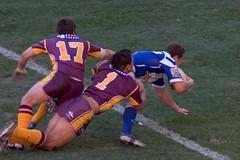 american football(0.0), ball(0.0), football(0.0), gridiron football(0.0), australian rules football(1.0), football player(1.0), sports(1.0), rugby league(1.0), rugby union(1.0), rugby football(1.0), rugby player(1.0), team sport(1.0), tackle(1.0), player(1.0), rugby sevens(1.0), ball game(1.0), ball(1.0),