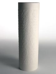 glass bottle(0.0), drinkware(0.0), bottle(0.0), glass(0.0), ceramic(0.0), lighting(0.0), cylinder(1.0),