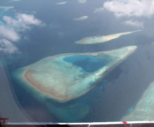 ocean blue cloud coral island maldives windowseat atoll