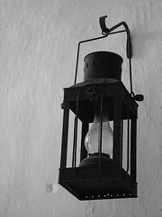 light fixture(0.0), sconce(0.0), church bell(0.0), street light(0.0), lighting(0.0), lamp(1.0), white(1.0), light(1.0), monochrome photography(1.0), iron(1.0), monochrome(1.0), black-and-white(1.0), black(1.0),
