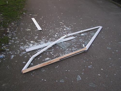 Broken window frame - storm damage