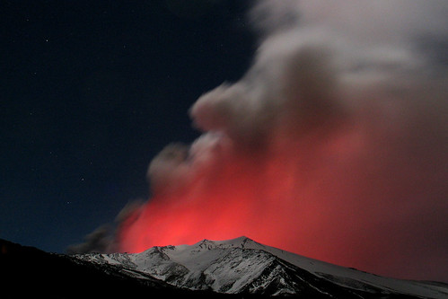 Montagnola and glow of Etna