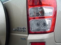 tire(0.0), automotive tire(0.0), wheel(0.0), rim(0.0), grille(0.0), vehicle registration plate(0.0), automobile(1.0), automotive tail & brake light(1.0), automotive exterior(1.0), vehicle(1.0), bumper(1.0),
