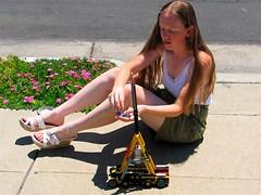 footwear, vehicle, girl, limb, leg, human body, blond, sitting,