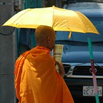Monk with a Yellow Umbrella - Phnom Penh, Cambodia