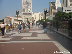 boardwalk(0.0), lane(0.0), pedestrian crossing(0.0), zebra crossing(0.0), road(1.0), crowd(1.0), urban area(1.0), town square(1.0), city(1.0), downtown(1.0), plaza(1.0), walkway(1.0), street(1.0), pedestrian(1.0), infrastructure(1.0),