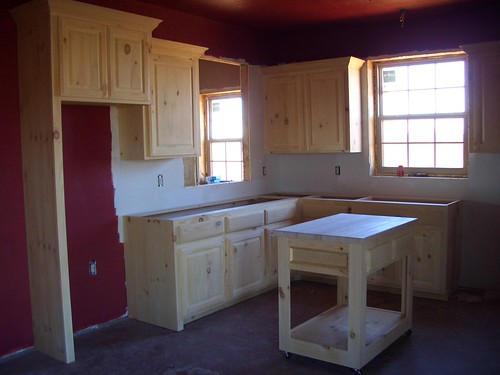 Knotty pine cabinets natural log siding for Knotty pine kitchen cabinets