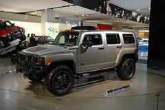 hummer h2(0.0), hummer h3t(0.0), automobile(1.0), automotive exterior(1.0), sport utility vehicle(1.0), vehicle(1.0), hummer h3(1.0), auto show(1.0), off-road vehicle(1.0), bumper(1.0), land vehicle(1.0), luxury vehicle(1.0),