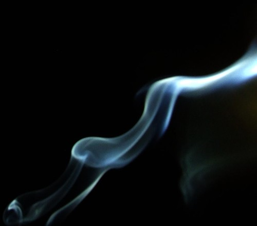 Incense smoke against a black sky