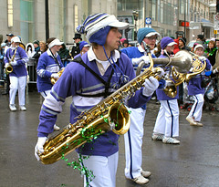 tuba(0.0), festival(1.0), sousaphone(1.0), marching band(1.0), musician(1.0), musical ensemble(1.0), music(1.0), marching(1.0), costume(1.0), brass instrument(1.0), wind instrument(1.0),