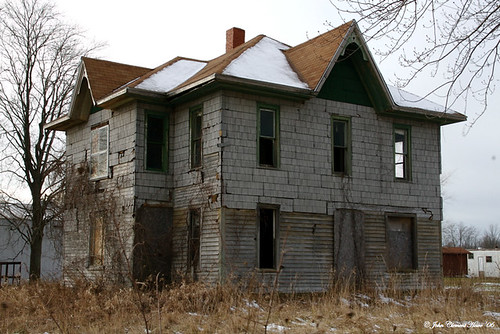 Abandoned House with Hipped and Gabled Roof