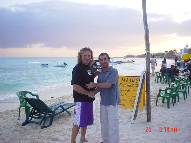 With my friend, Robert Plant in Playa del Carmen.  A handshake beats an autograph.