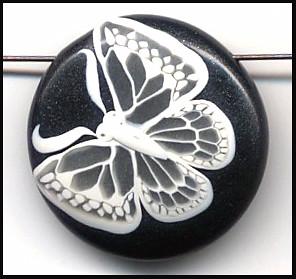 Translucent butterfly on metallic black background.